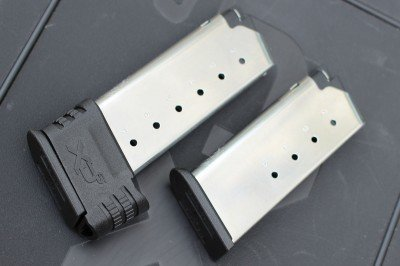 The shorter mag holds five rounds. The other holds seven.