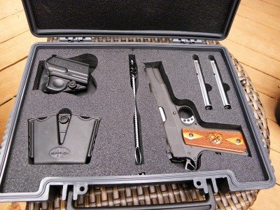 In addition to a rugged fitted case, the Range Officer includes a paddle holster, dual mag carrier, and cleaning brush.