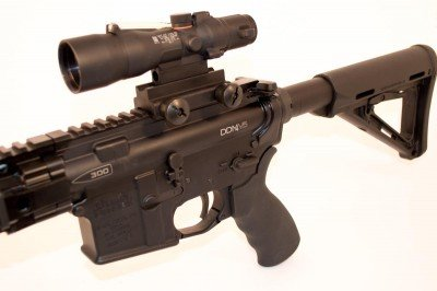 The DDM4v5-300 is shown here with a Trijicon 3x30 ACOG with a special 300 Blackout reticle. It has hold points for supersonic and subsonic rounds.