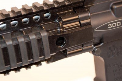 Quick Detach holes are on both sides of the DDM4 rail, front and back.
