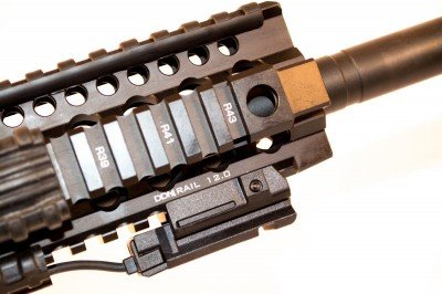 The DDM4 rail, shown here with a LaserMax UNI-MAX ES on the bottom rail with remote activation pad on the right side rail.