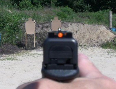 "Laser Ammo recommends a ""dot over dot"" sight picture with a six o'clock hold."