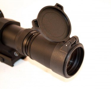The Leupold includes sturdy flip up caps.