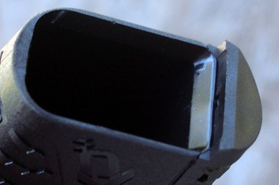 The mag well has modestly beveled edges, but is still easy enough to load on the fly.