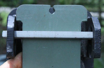 The swinging plates drop into slotted crossbars. There is no hardware on the target itself, just steel plates.