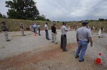 Trainees line up before their targets at the Shield Solutions range near West Planes, Missouri.  (Photo: Kansas City Star)
