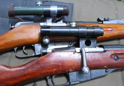 We bought two Mosin-Nagant snipers on GunsAmerica for this article. As you can see there are two versions of the excellent Russian PU scope, one black and one green.