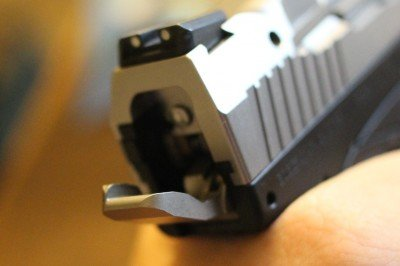 The hammer is a flat paddle that opens up the back of the pistol.