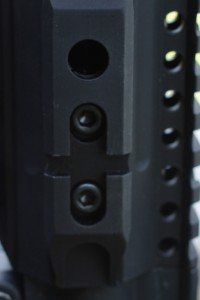 The forend connects to the barrel nut with several hex screws.