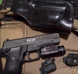 I tried three different rail-mounted lights with the Sig and Galco HALO. All fit just fine.