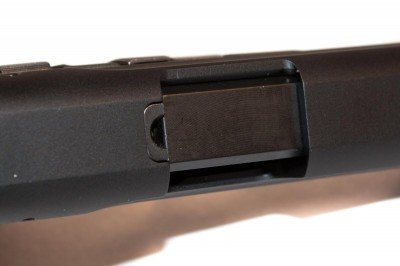 The loaded chamber indicator is a small cutout in the top of the slide that allows visual check of the chamber status.