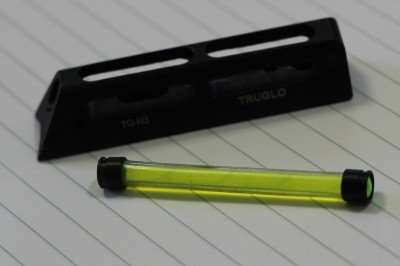 The tube slides into the milled frame, which pins in place on the barrel.