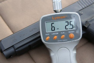 The trigger pull is in the normal range for Glocks, about 6 lbs. with a crisp break at the end.