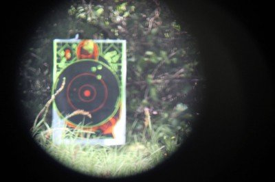 "This is a hard review to document on film. The images taken through the scope aren't indicative of the quality. This is a target seen from 100 yards. The center circle is 12""."