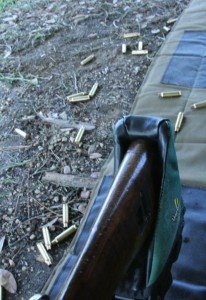 The brass flies pretty much straight up, so if you are standing it goes forward, and prone it goes back.