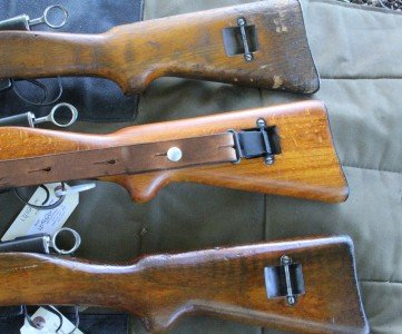 The top rifle is the old gun. The beech stocks on many of the old guns have worn away for some reason.  The second gun is the new unissued beech rifles, and the bottom is the walnut stock.