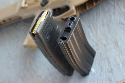 There's no mistaking the magazine. A loaded AR mag won't seat inside the Airsoft mag well.