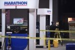 Gas station gunfight leaves two robbers dead, good guy wounded