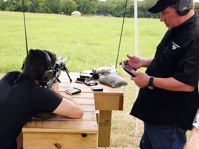 Scott Calvin uses the included iPad to coach a shooter. He can see everything the shooter can see through the scope. In fact, you don't even have to look through the scope to shoot your target. You can simply use the iPad or your cell phone for your sight picture, allowing you to shoot around corners without exposing yourself to enemy fire. But, ah, that's another topic.