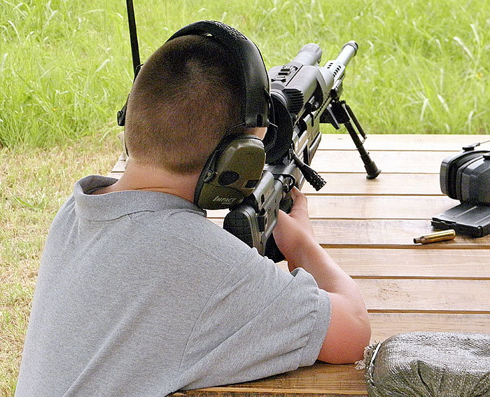 This whisp of a young man had no trouble handling the recoil of the .338 Lapua Magnum. In fact, he scored a bullseye.