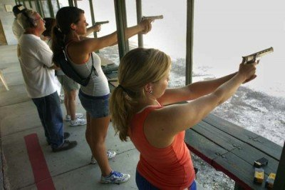 Women shooting at a gun range!   Don't freak out, and don't annoy them.  (Photo Jacksonville.com)