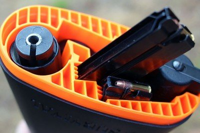 The magazines have channels stamped in that guide them into the gun, and into the stock.