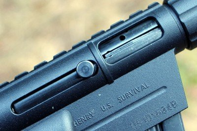 It is a simple blow-back design, and it works reliably, even when wet or dirty or fouled by the rimfire rounds.