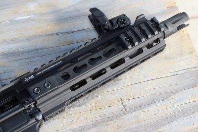 The 7.5 inch barrel is short, but long enough. The flash hider disipates the flash well, but not the noise.