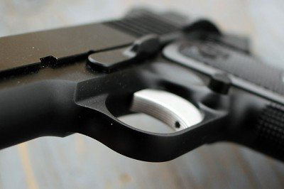 The trigger guard has smooth lines.