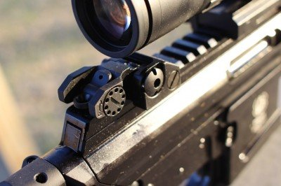 The rear sight folds neatly below a scope, and is there if you need it.
