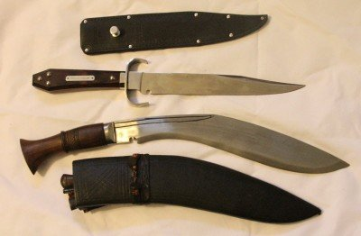 The top one is my Ontario Hell's Belle. I like the belt button sheath, the coffin shaped handle, and the overall weight and balance.