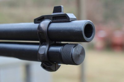 The front sight is built into a barrel band.