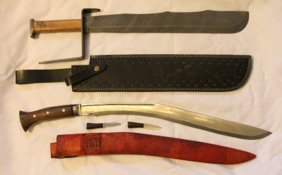 These are the two short swords mentioned in the article. The top one is 3 lbs. and has that giant hand guard, which is itself a hammering weapon. The bottom is my long Kukri, and not my first choice in a hand to hand combat weapon.