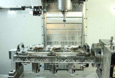 This is the CNC machine just after it opens with 3 finished guns.
