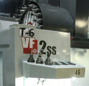 The CNC bits that are used to complete the Model 22 revolve into place on the robot CNC machine.