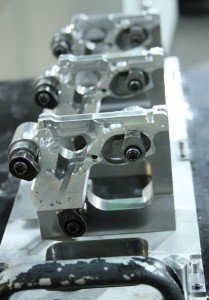 The Model 22s are built in threes, clamped to a carrier system.