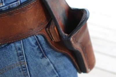 Note the leather block behind the holster to push the grip out from the hip.