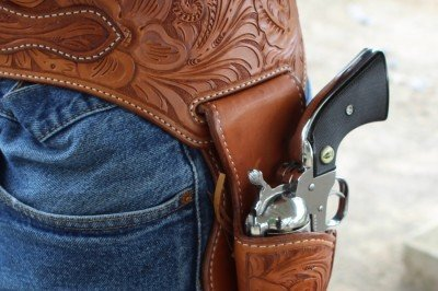 The holster rides in a cut out in the belt. All edges are stitched for extra strength.