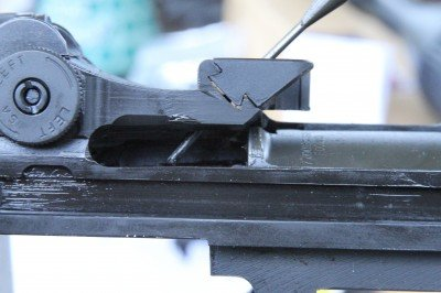 This is the dovetail that holes the stripper clip guide on the M1A. As you can see, I am pushing the lock pin out with a 3/32 punch.