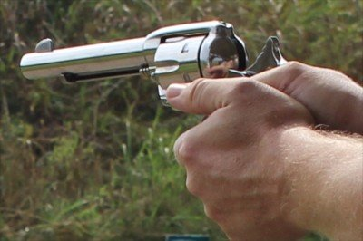 A two handed grip helps hold down the muzzle flip, which can be significant depending on the .45 load you are shooting.