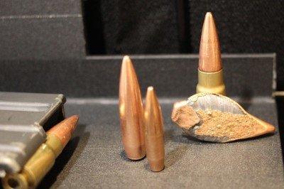 Next to a .30 Caliber bullet.