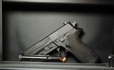 If you're in need, this SIG Sauer P227 in a wall safe is a friend indeed.