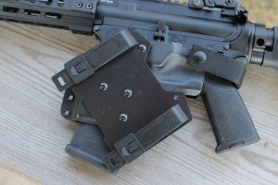The mount allows for attaching the holster to MOLLEE or to a belt.
