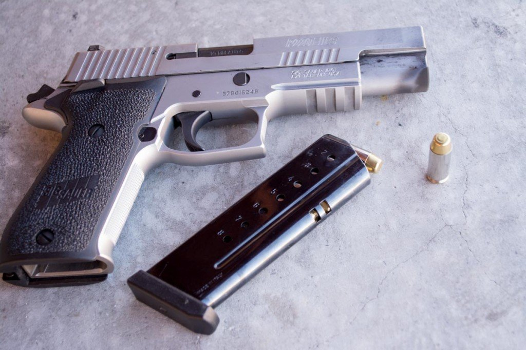 That cartridge is too short to be a .40 S&W! It's the new Sig P220 chambered in 10mm.
