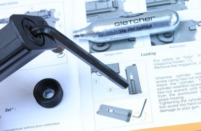 The air cartridge also fits in the magazine, and the gun comes with this Allen wrench to change cylinders.