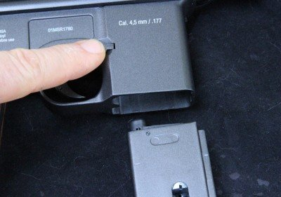 The gun uses the real magazine release like on the real Mauser.