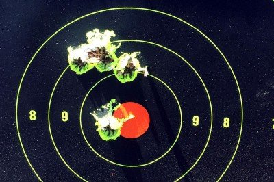 100 yards, top group is one 4 shot group from bipod. Bottom group is 2 shot group after sight adjustment.