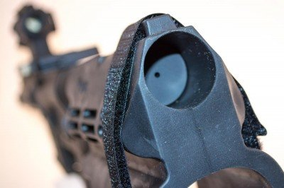 The Sig brace just slides over the buffer tube.