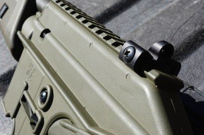 the rear sight sits on the rail.