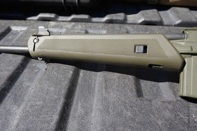 The forend pops open at the touch of a button.
